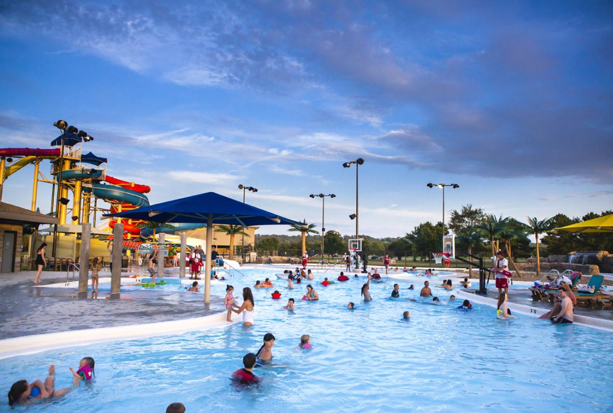 People enjoying Parrot Island Water Park in Fort Smith