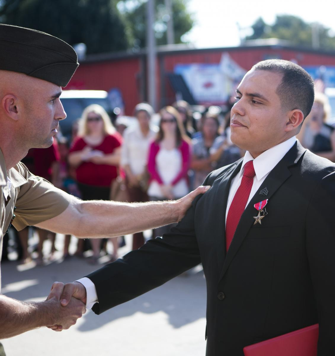 Veteran student shaking hands with officer