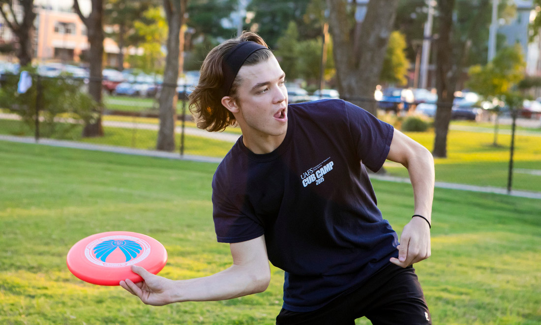 Student playing frisbee during Intramurals