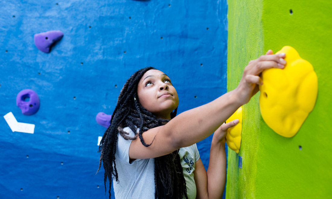 Student using the climbing wall at the RAWC